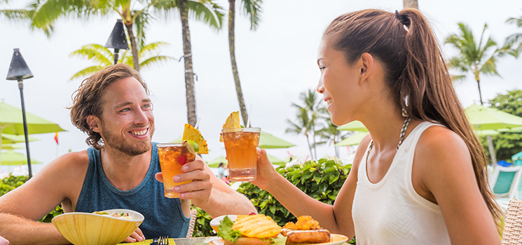Couple eating at tropical restaurant on vacation